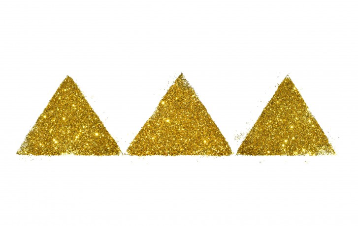 Three abstract triangles or pyramids of golden glitter sparkle